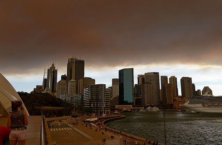 Smoke and ash from wildfires burning across the state of New South Wales bl